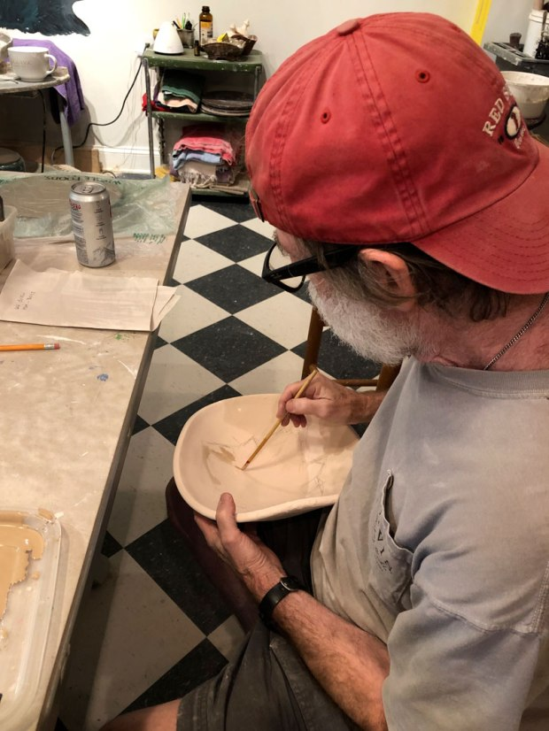 Gare painting glaze on a pot